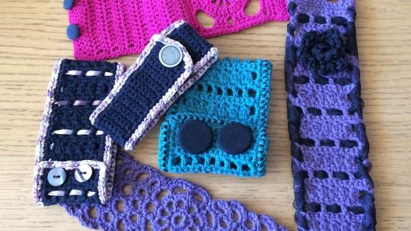 black, green, purple and pink crochet cuffs