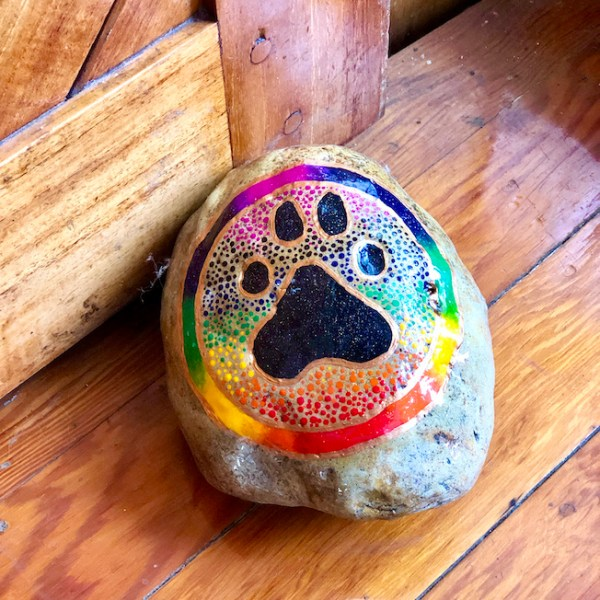 Natural Stone with animal paw design in black and rainbow colours frame as a door stop