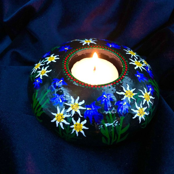 hand cast, hand painted tea light holder with Edelweiss and Gentian Violet Design