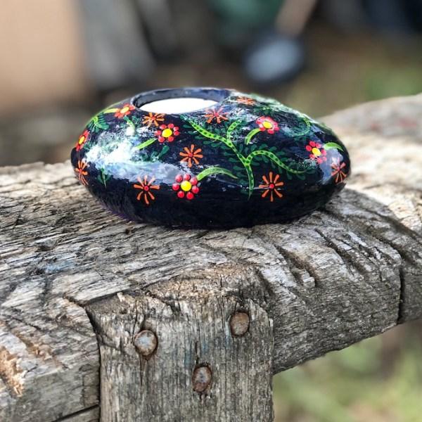 Oval tea light holder with folk art flowers pattern side view
