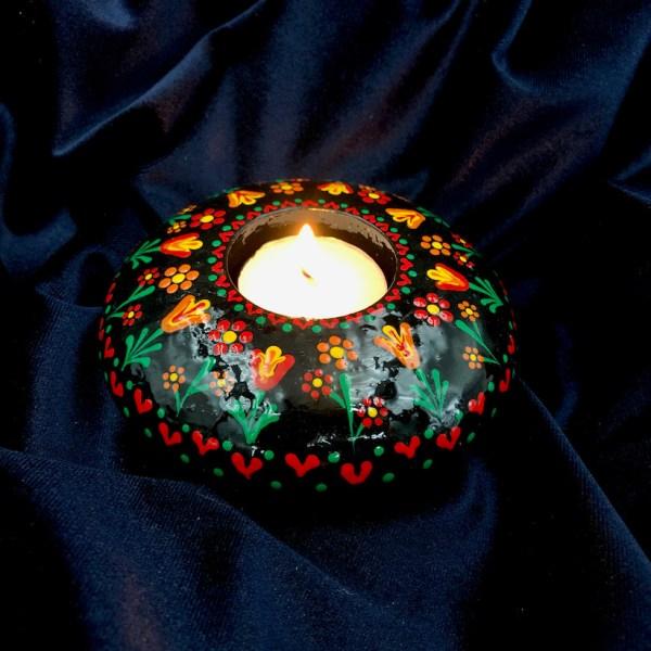 hand cast hand painted tea light holder round with folk art tulip pattern