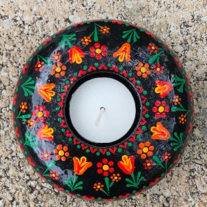 hand cast hand painted tea light holder round with folk art tulip pattern top view