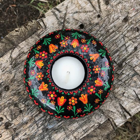 hand cast hand painted tea light holder round with folk art tulip pattern on wood