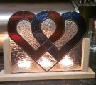 Stained Glass Hearts with wooden surround and 3 tea light holders.