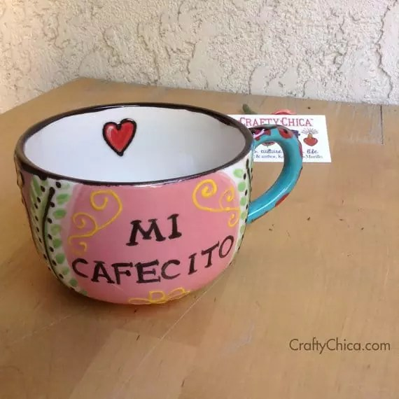 Fired ceramic mug. Perfect for cafecito and pan dulce!The black lines are dimensional Mi vida feliz mug by Crafty Chica.