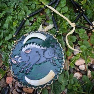 Wild boar tusk medallion