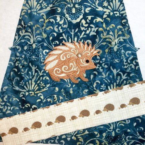 """I embroidered the hedgehog onto the front piece after cutting. The pattern has a marking for the """"visual center of the bag"""" so placment was easy and perfect!"""