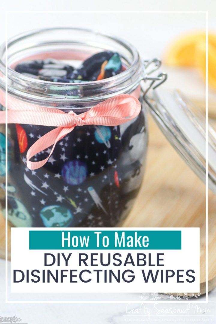 DIY Reusable Disinfecting Wipes in a glass jar with a peach colored ribbon tied around it