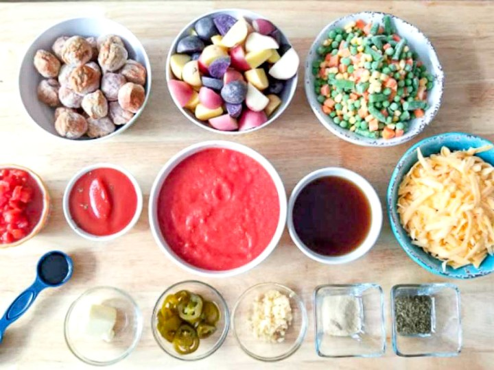 Instant Pot Hearty Meatball Vegetable Soup Recipe ingredients on a wooden table