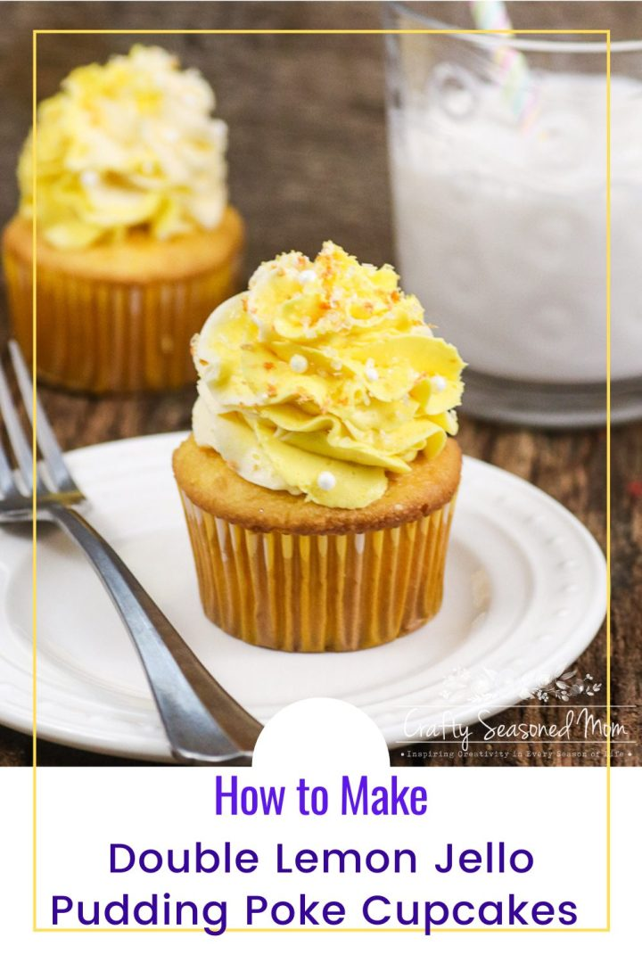 1 cupcake next to a glass of milk on a white plate with a silver fork and one cupcake on a wooden table for the Double Lemon Jello Pudding Poke Cupcakes Recipe