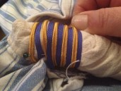 I pinned, wound and sewed down aternating rows of ble and gold cord to complete the look.