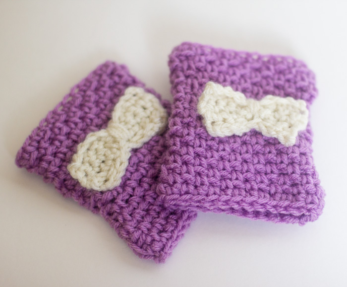 Fingerless gloves with bow variation.