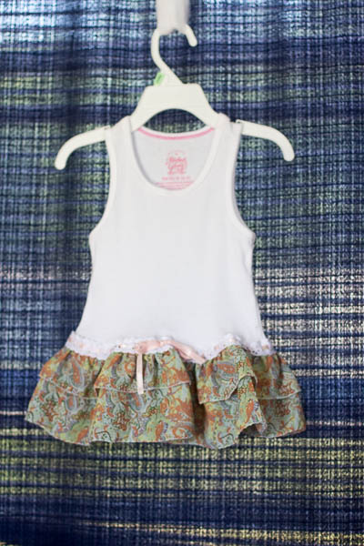 Recycle onesies - quick an easy project to recycle onesies into a baby dress. You can also use a tank top. Great for last minute baby shower gifts.