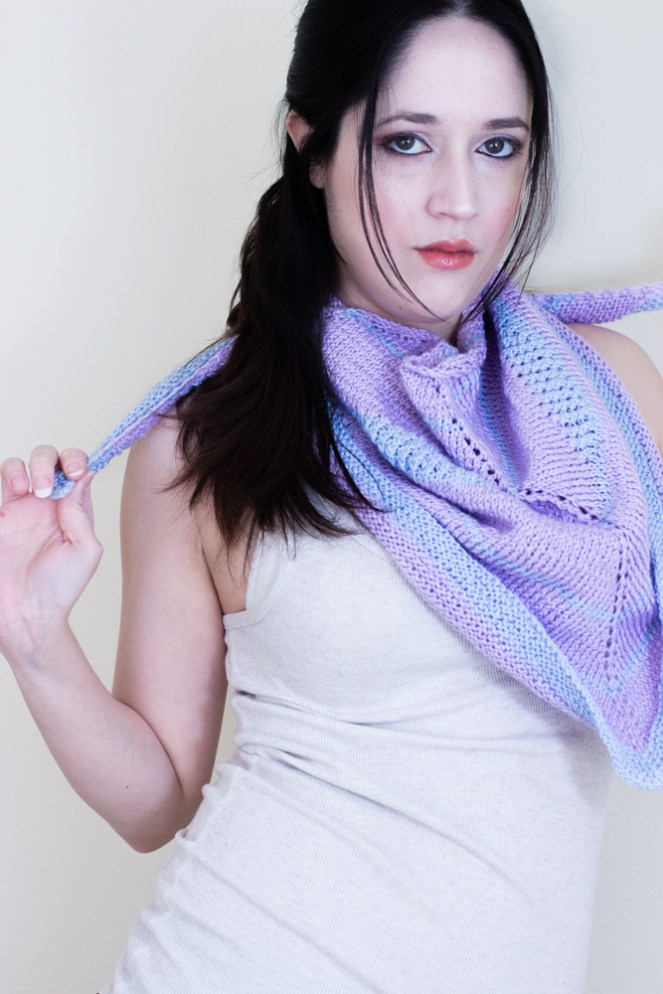 """The Cotton Candy Swirl is a symmetrical triangular shawl, knitted top down, using two colors and featuring short rows """"swirls"""" to add interest and ornament to an almost traditional shawl shape."""