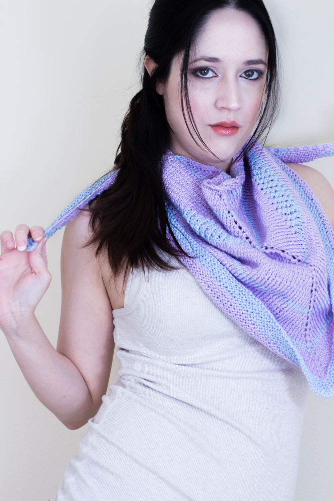 "The Cotton Candy Swirl is a symmetrical triangular shawl, knitted top down, using two colors and featuring short rows ""swirls"" to add interest and ornament to an almost traditional shawl shape."