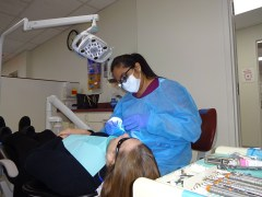 Kristine San Diego, a third-year student at the School of Dental Medicine, works on a patient at the school's clinic. (Craig Ruark/Las Vegas Business Press)