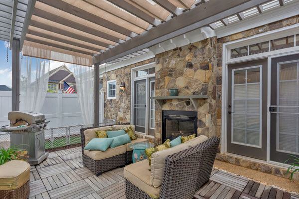 Beautiful Craig Builders patio on The Villager Courtyard home plan. Featuring an inside-outside fireplace.