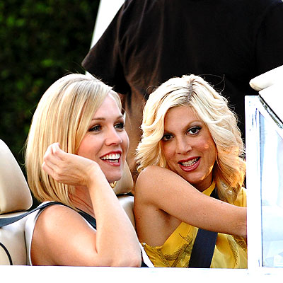 Jennie Garth as Kelly Taylor and Tori Spelling as Donna Martin Silver