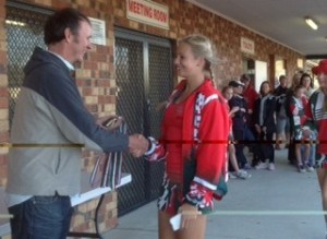 Presentation to one of Redlands' young netball players