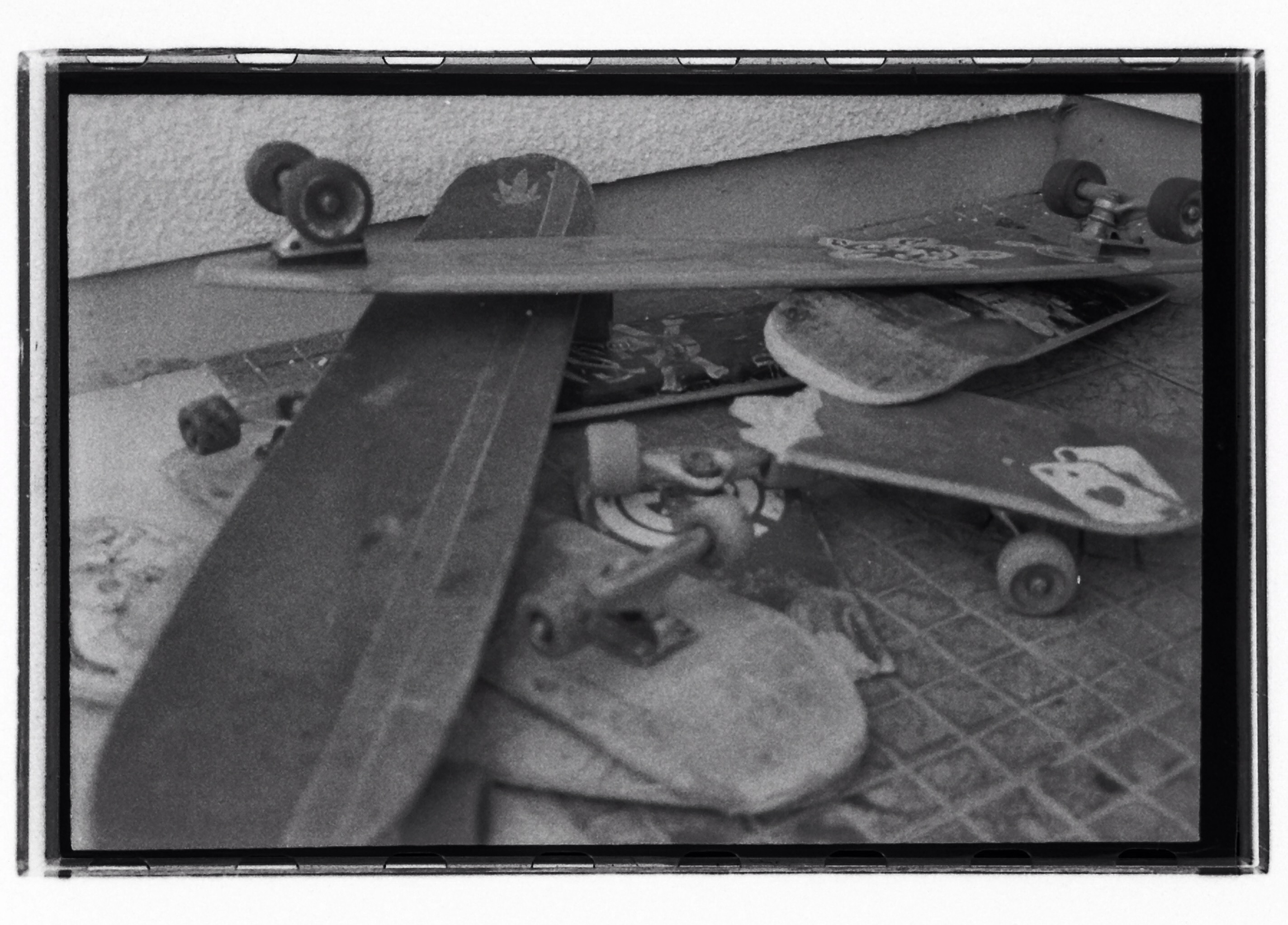 broken skateboards 35mm phone scan. College documentary photography project. Self processed 35mm.