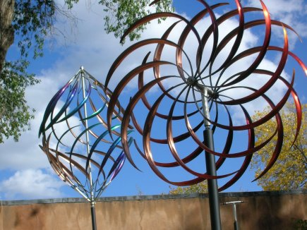 Mark White calls his creations kinetic sculptures. They move in enchanting and hypnotic ways.