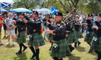 Bagpipers march out with their clans during the Southeast Florida Scottish Festival. (Craig Davis/Craigslegz.com)