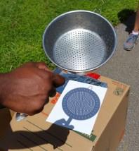 A colander projected many images of the eclipse. (Craig Davis/Craigslegz.com)