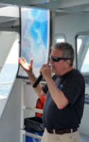 Dennis Minsky is one of eight naturalists who double as MC's on the four vessels operated by the Dolphin Fleet. (Craig Davis/Craigslegz.com)