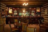 The cozy Owl Bar features a rosewood bar was built in Ireland for Robert LeRoy Parker, the real Butch Cassidy.