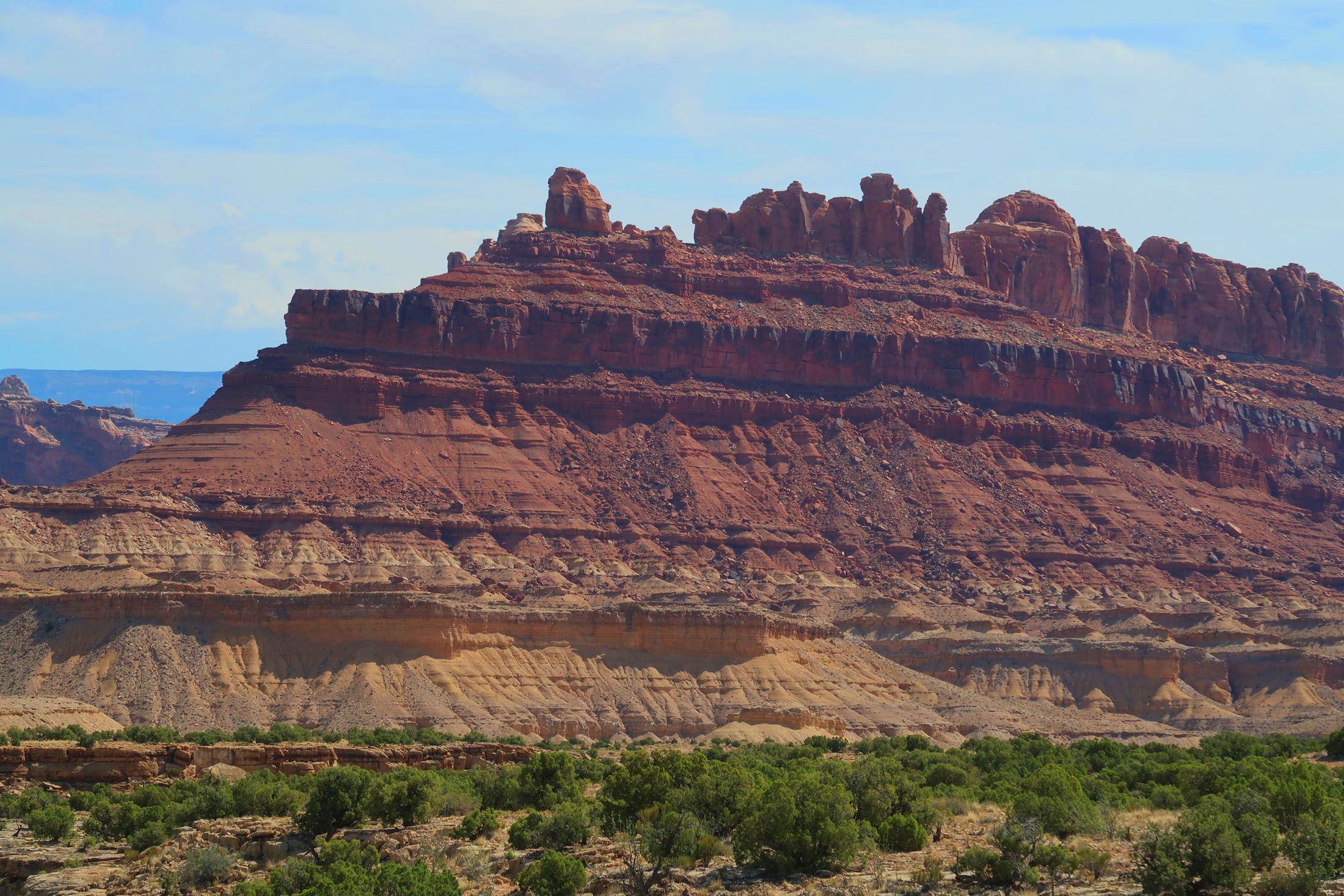 The colorful cliffs of the San Rafael Reef in Utah are composed of sedimentary layers of rock deposited more than 250 million years ago. (Craig Davis/Craigslegztravels.com)