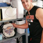 Jose Fernandez shows a bag from San Diego's first All-Star Game in a storage closet at Petco Park a month before pitching in the second one in 2016. (Craig Davis/Craigslegztravels.com)