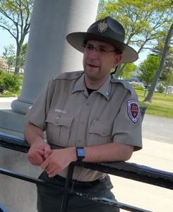 Matt Villamaino, of the park service at Pilgrim Memorial State Park, tells how Plymouth Rock has been moved and gotten smaller over the years. (Craig Davis/Craigslegztravels.com)