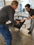 Richard Dextraze, left, directs the shaping of a glass tumbler at Hollywood Hot Glass. (Fran Davis/Craigslegztravels.com)