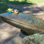Bebop gets up close with the big frog in Riverside Park in Chagrin Falls, Ohio. (Craig Davis/Craigslegztravels.com)