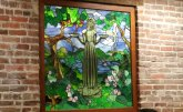 "A strained-glass window depiction of the Bird Girl statue is in Clary's Cafe, which was an important setting in ""Midnight in the Garden of Good and Evil."" (Craig Davis/CraigslegzTravels.com)"