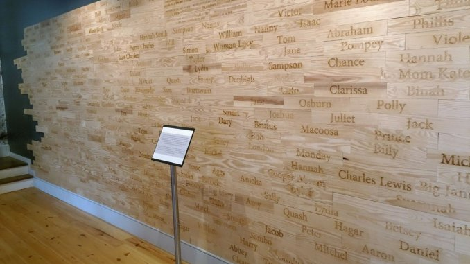 The wall of names of verified enslaved persons who worked in the Owens-Thomas House over the years. Planks were left blank for the names that have been lost to history. (Craig Davis/Craigslegztravels.com)