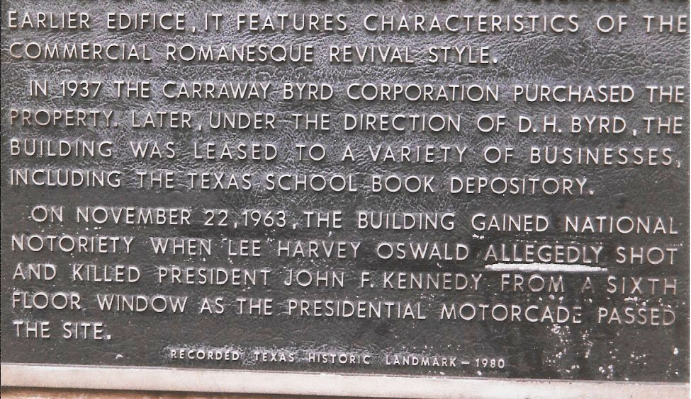 The word 'allegedly' has been underscored on the plaque on the former Texas School Book Depository in Dealey Plaza. (Craig Davis/craigslegztravels.com)