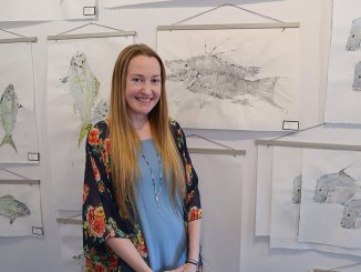 Artist Lisa Lee with her Gyotaku fish prints at Gallery of the Arts in Tavernier, Florida. (Craig Davis, craigslegztravels.com)