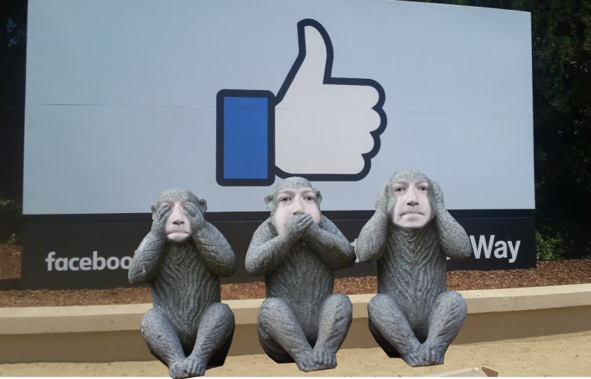 The Facebook '1 Hacker Way' sign, before it sit the Three Wise Monkeys (hear no evil, see no evil, speak no evil), their faces replaced with that of Mark Zuckerberg.