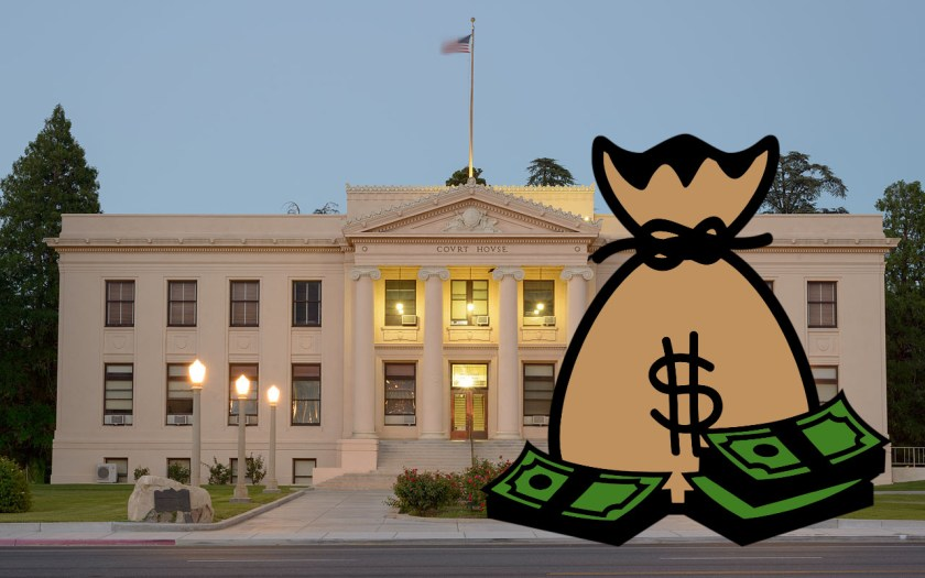 A neoclassical US courthouse overshadowed by a giant comic-book bag of money.