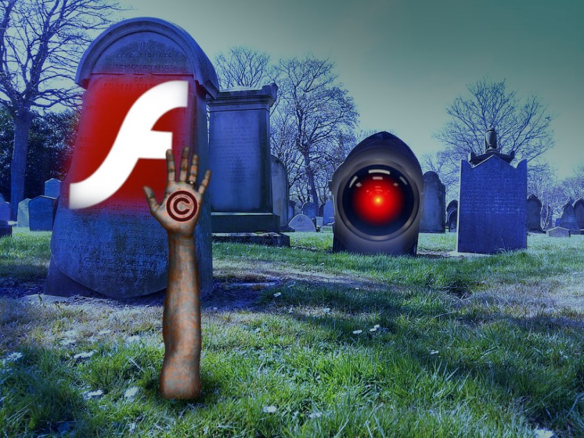 A spooky graveyard; in the foreground, a tombstone bearing the Adobe Flash logo, with a hand bursting out of the soil before it, bearing a copyright symbol. In the background, another tombstone sports the eye of 2001's HAL 9000.