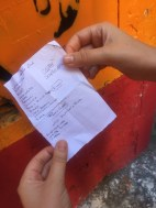 We went to the Totti mural in Rome and there was a hole in the wall with a stone in it. We pulled it out and there was this piece of paper sitting there. I think it's a shopping list. Strange place to keep it
