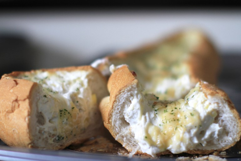 Artichoke dip stuffed bread appetizer perfect for fall football games