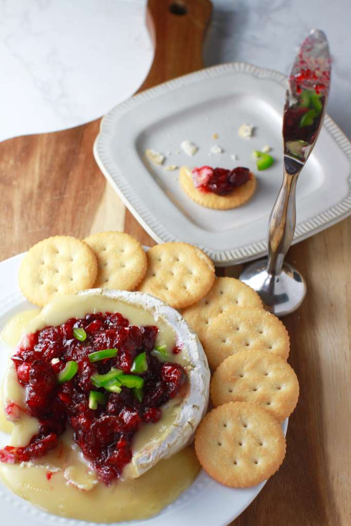 This delicious sweet and spicy brie recipe comes together without a whole lot of work involved. Just warm the brie and top with a simple 10 minute cranberry jalapeño sauce. It's so creamy and such an unusual combination, it will be gone in no time!