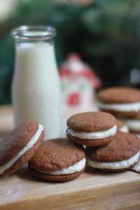 Molasses sandwich cookies with eggnog buttercream