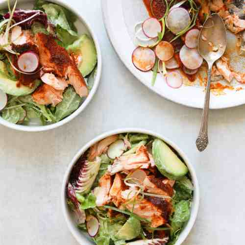 Oven Roasted BBQ Salmon Salad on a platter with two bowls of avocado ranch salad