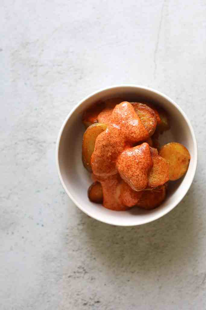 Patatas Bravas in a bowl with Smokey Tomato Aioli