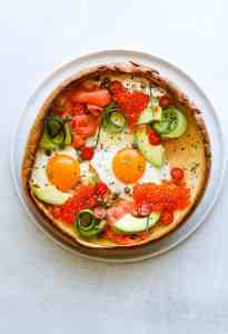 Savory Smoked Salmon Dutch Baby on a white plate