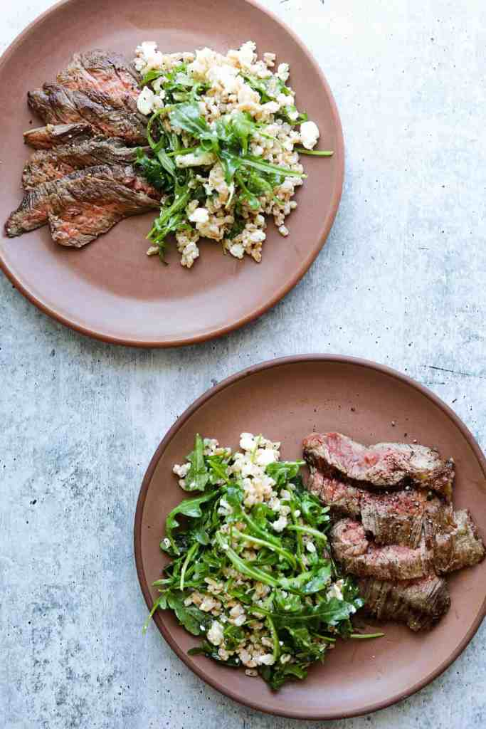 Two Plates of Five-Ingredient Steak Salad with Farro, Arugula, and Feta