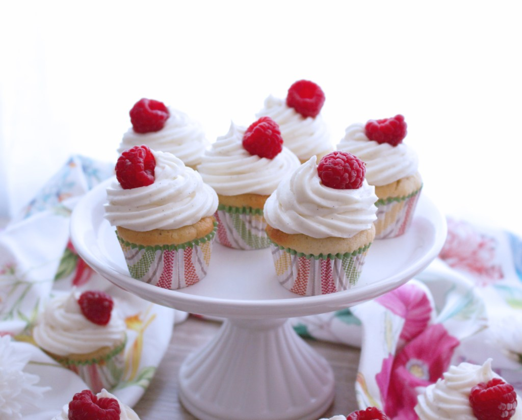 Mini lime cupcakes with surprise raspberry and vanilla frosting